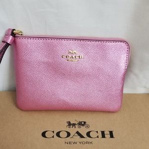Coach wristlet small pink metallic